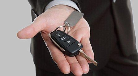 A man holding his car key fob