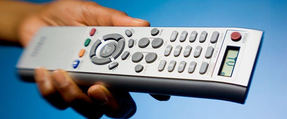 A close up of a TV remote