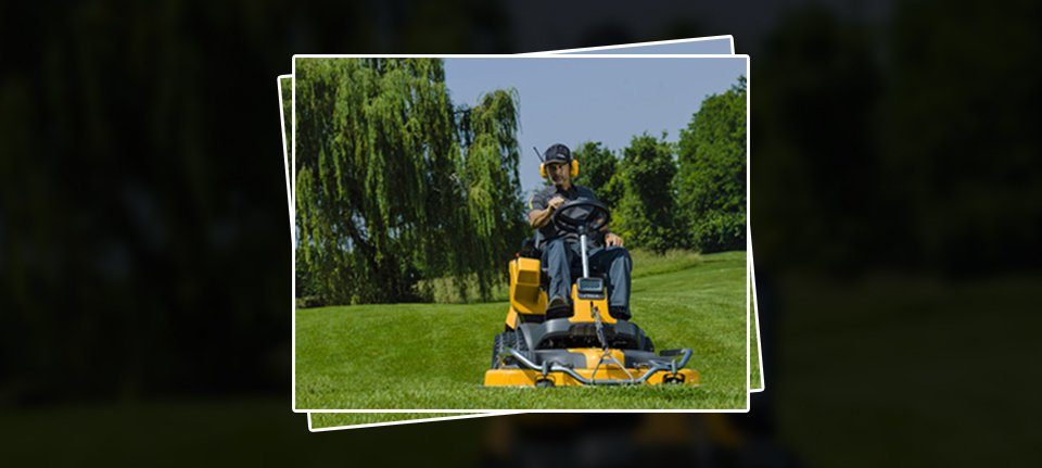 A man sitting on a ride on mower