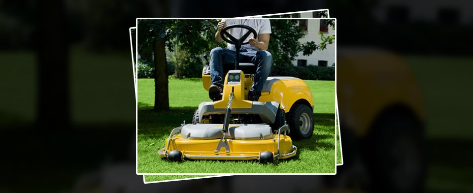 A man on a bright yellow, ride on mower