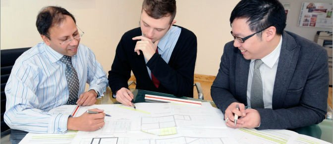 3 men thinking and drawing plans