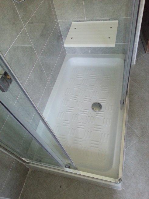 Piatto doccia con seggiolino