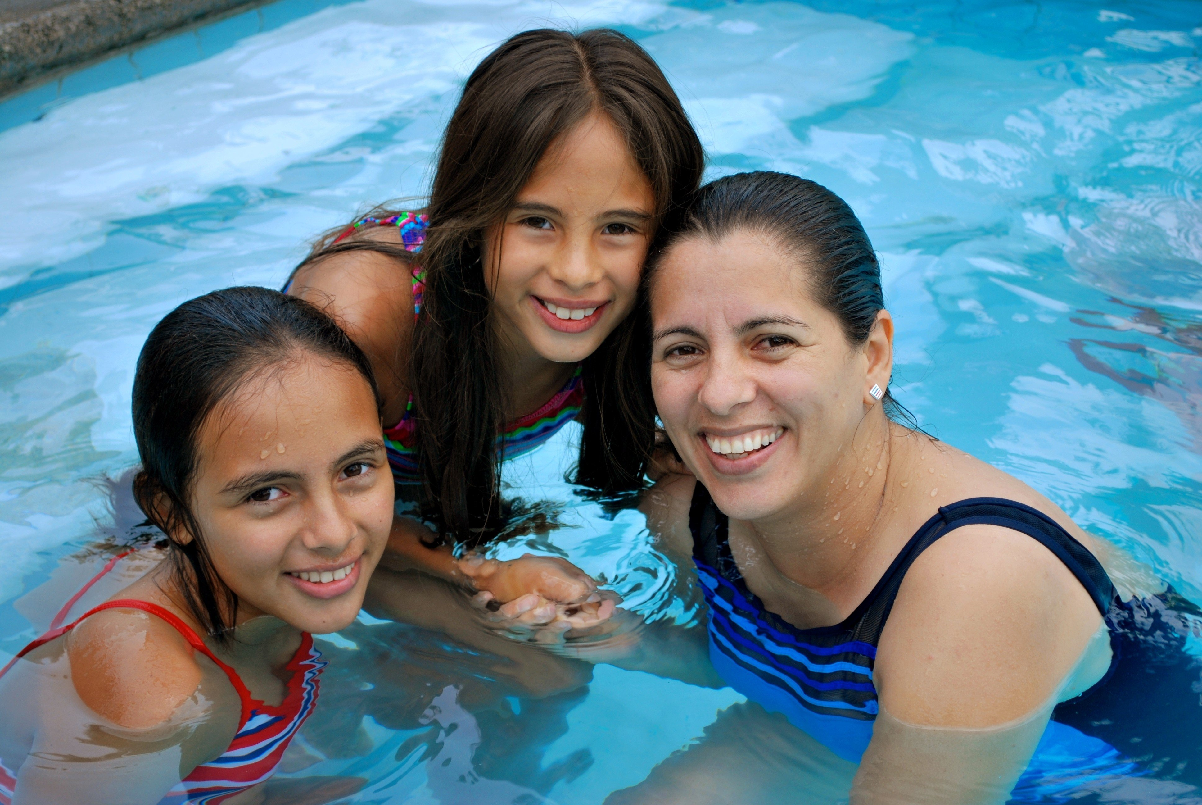 Smiling Family in Pool in Villa Serena Communities
