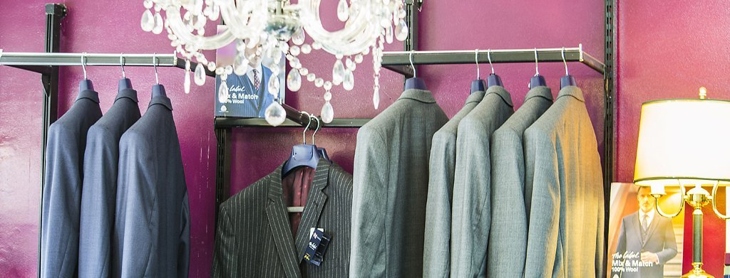 Made to measure suits hanging on a rail