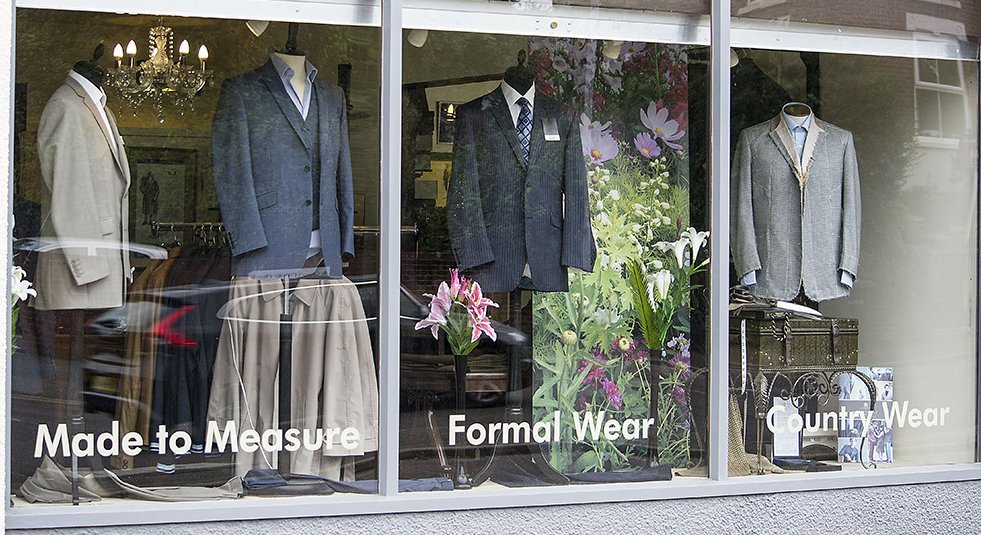 Shop window display of high quality tailored suits