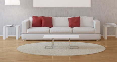 white sofa with maroon cushions