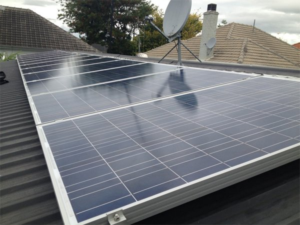 View of solar panel being installed on roof