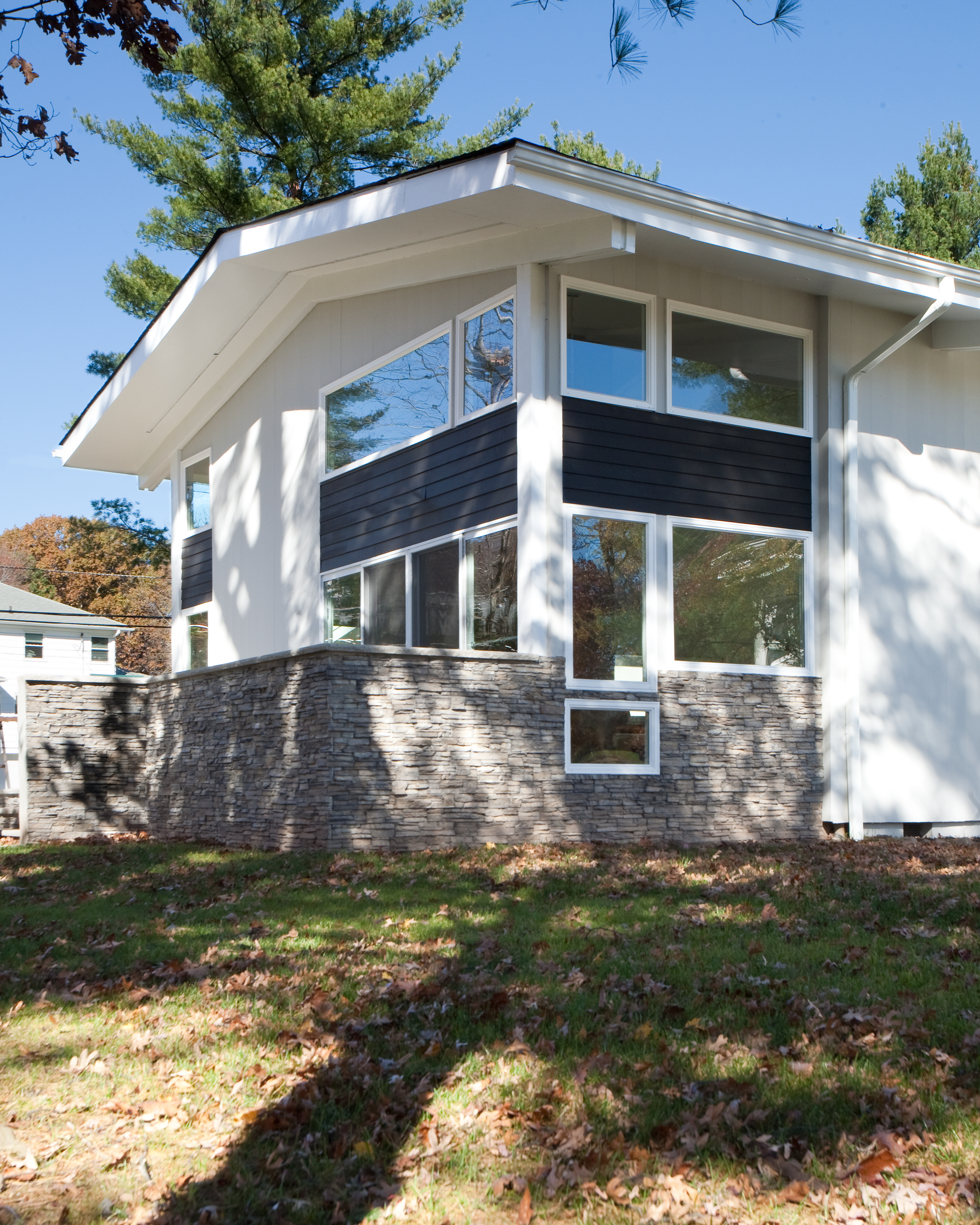 Modern residential architecture NJ. The existing porch was enclosed and incorporated into the living area