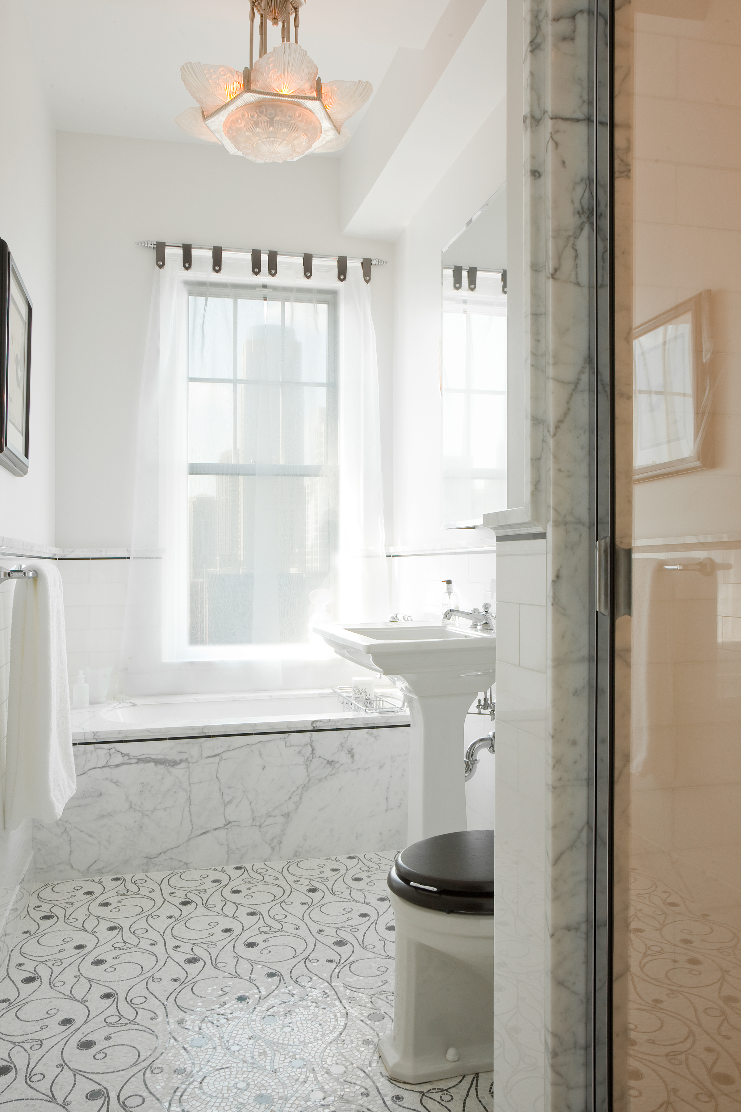 Modern residential architecture. In the hall bath, the mosaic pattern was used on the floor in combination with statuary marble and white tiled walls.
