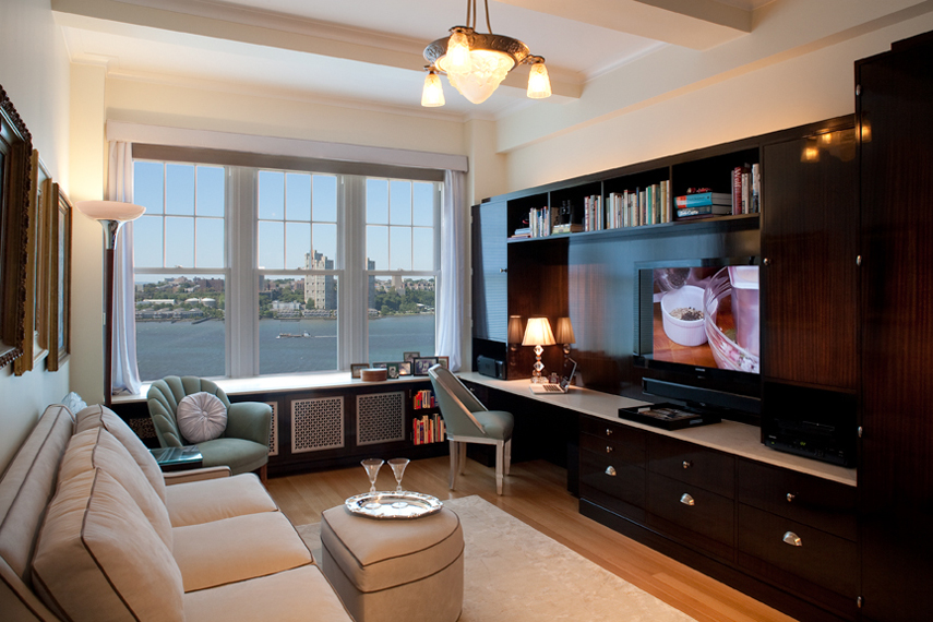 Modern residential architecture. Ebony cabinetry was designed to create a luxurious den overlooking the Hudson River.