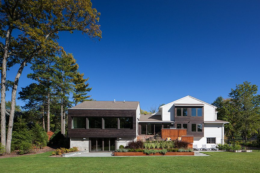 The new owners of this expanded Livingston NJ ranch wanted to modernize their home as well as add living space with height that reached beyond their existing 8' ceilings.  The rear addition included a dramatic great room, new dining area and playroom.  The upper deck, designed to be accessible from the existing and new  living spaces, is anchored to the ground with tiered Corten steel planters, connecting to the lower deck with a gentle progression. Interior Designer Satomi Yoshida-Katz of YZDA in Montclair collaborated with us on the interiors.