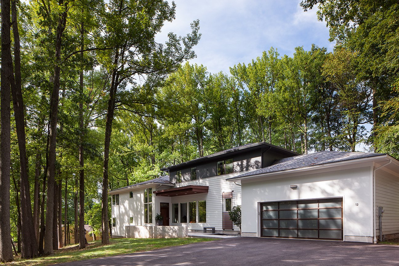 A typical mid century split level home was transformed through several additions, a complete renovation, and a dynamic re-thinking about the idea of the split level. Located in Scotch Plains.