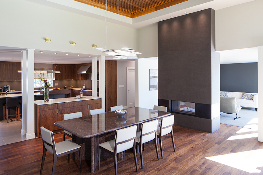 Modern residential architecture. Dining area with view to kitchen and Living Room.