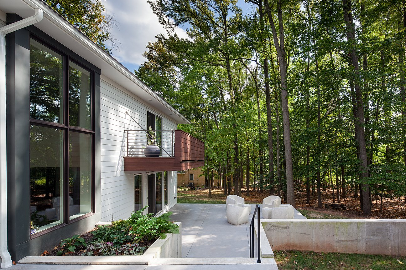 Modern residential architecture. Scotch Plains Back of house. Cantilevered 2nd floor terrace.