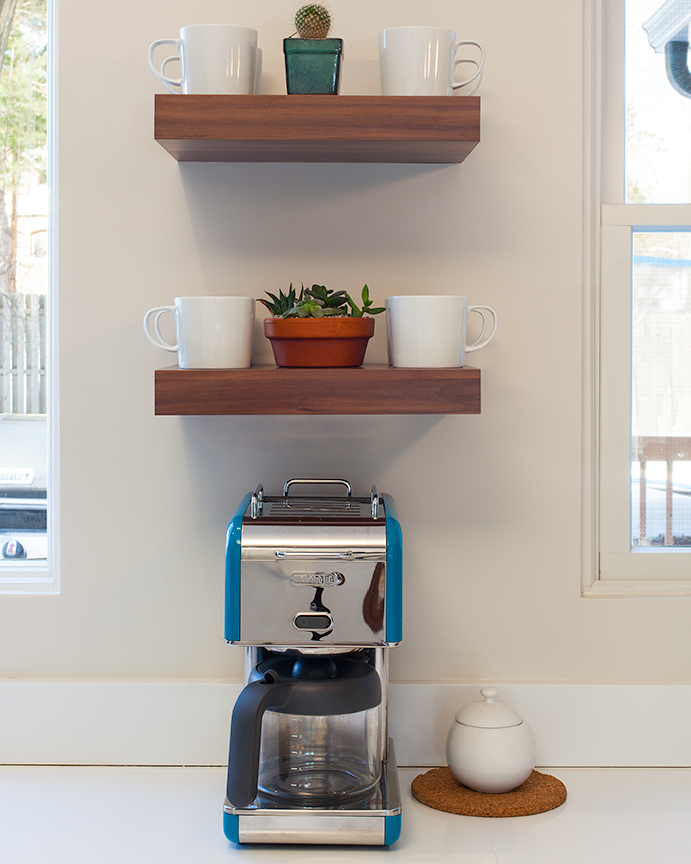 Modern residential architecture NJ. Detail of coffee maker under floating thick wood shelves.