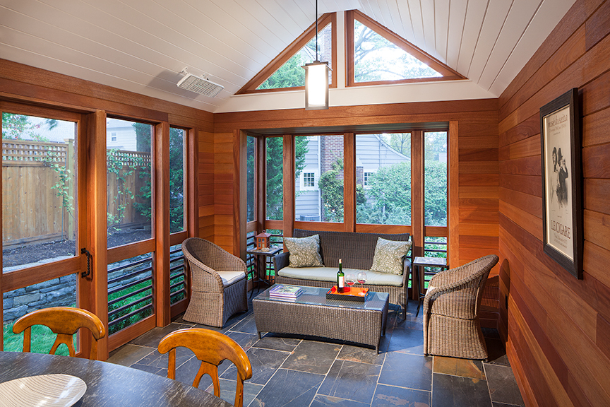 Modern residential architecture. Slate floor and mahogany clad walls give the porch interior substance and warmth.