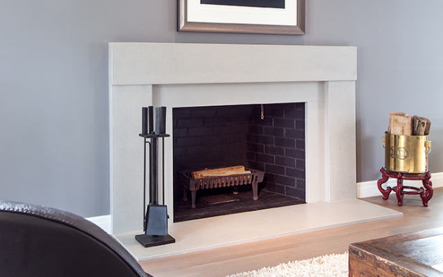 Modern residential architecture. A fireplace is a focal point of a room, a place of gathering and warmth. Surrounding materials are selected to enhance the overall style and feel of the space. Gas fireplaces have become popular for ease of use, while providing environmental benefits.