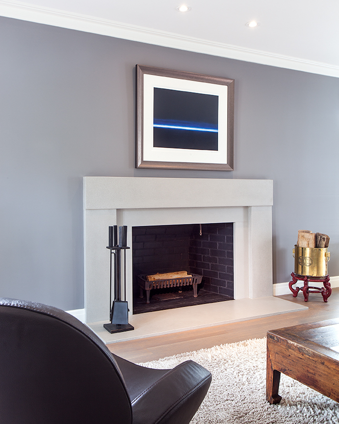 Modern residential architecture NJ. The concrete fireplace surround was designed to further enhance the modern aesthetic of the interior renovation.