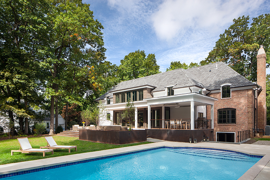 Modern residential architecture NJ. The back of house addition expands the kitchen, creates a new master bedroom suite, and includes a new covered porch, deck, and Corten steel planters.