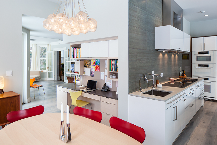 Modern residential architecture. The custom desk area links the kitchen to the family room.