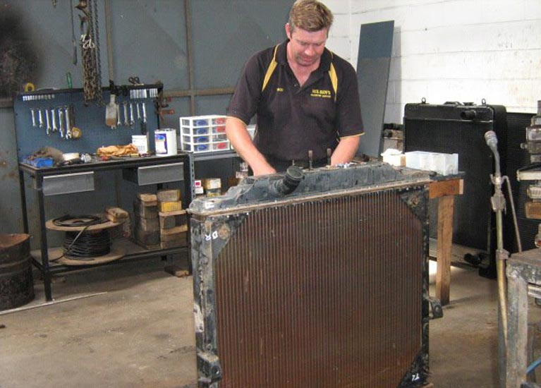 neilsens radiator service man repairing radiator
