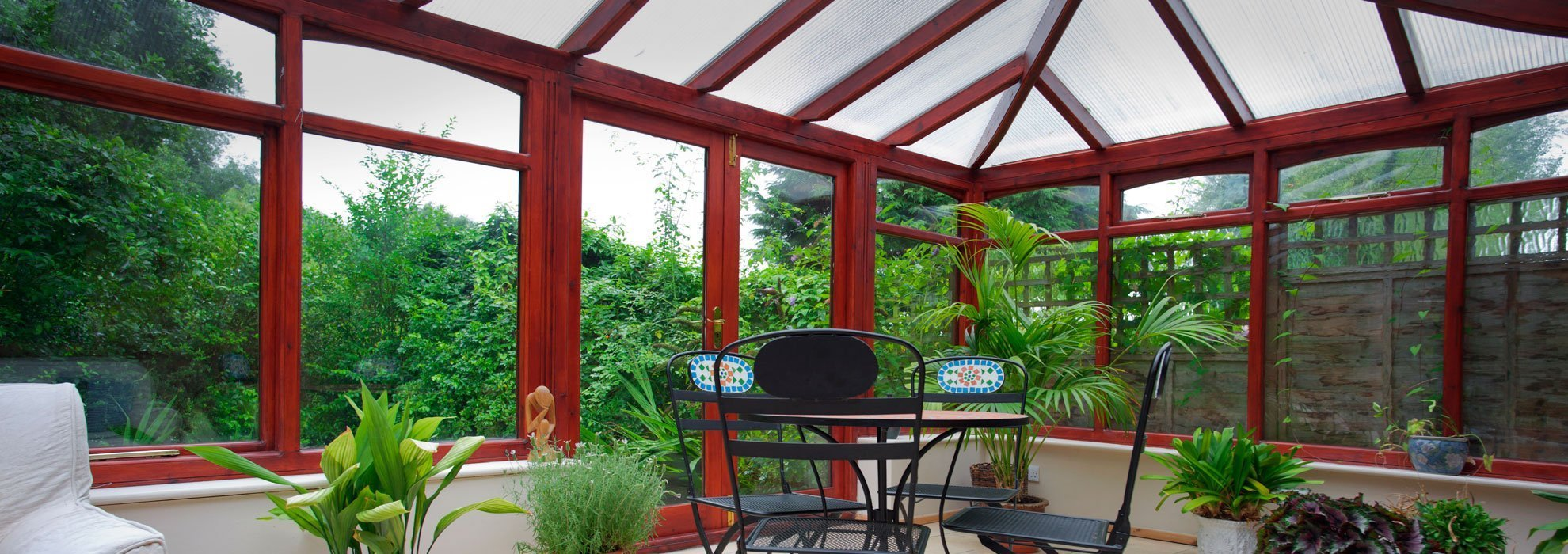 wooden frame conservatory with frosted glazing