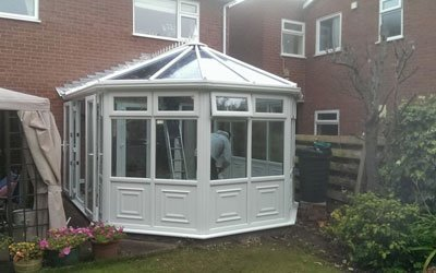 white conservatory with glazing