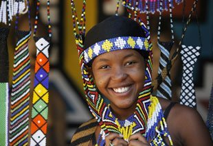 African girl with beaded necklaces and head dresses