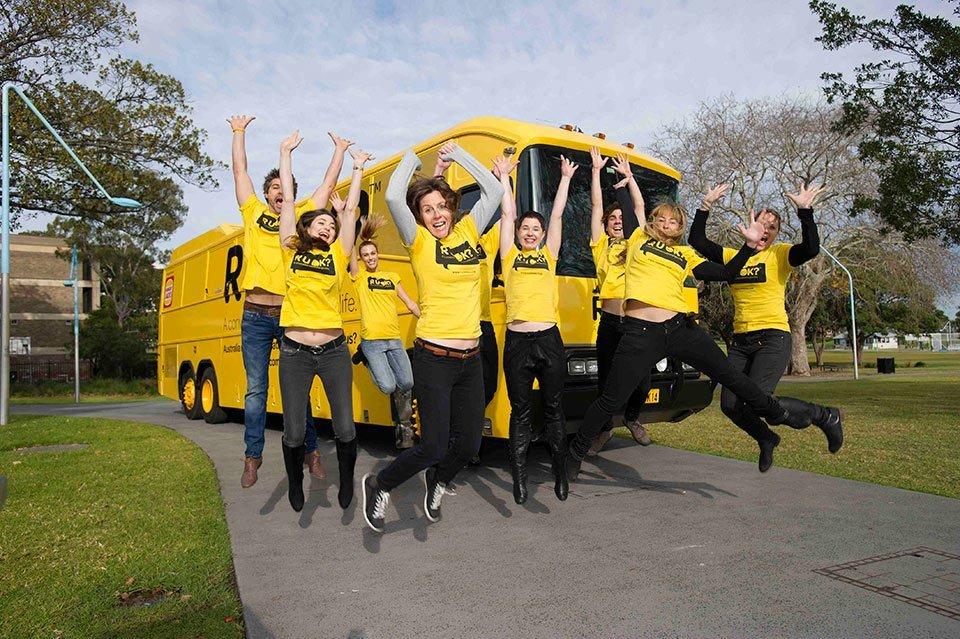 The bright yellow R U OK? bus on site in Darwin with volunteers