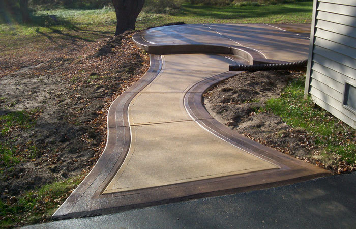Professionals providing garage floor cleaning services for a new concrete patio in Sullivan, WI