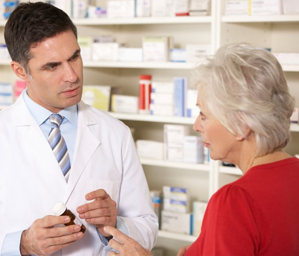 Pharmacist at a Chemmart Pharmacy talking to a Melbourne patient