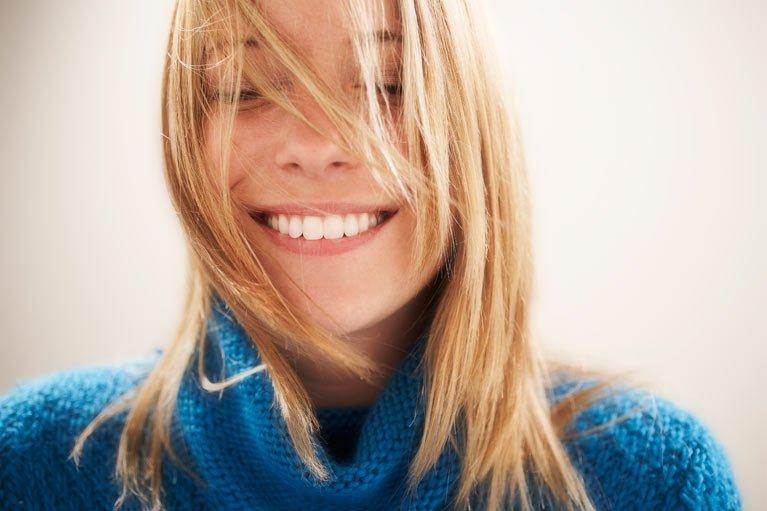 girl in winter jumper smiling