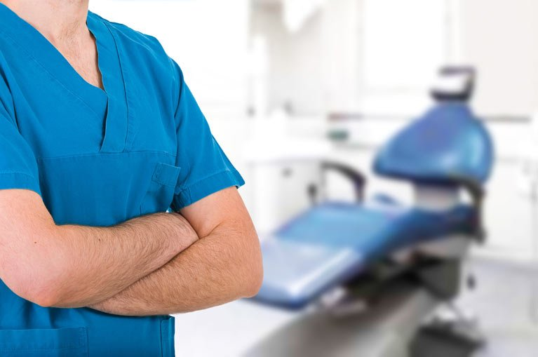 dentist standing in dental surgery