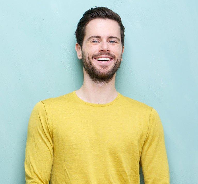 man in yellow shirt smiling