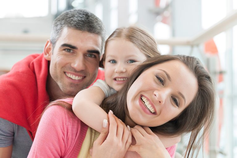 family smiling and hugging