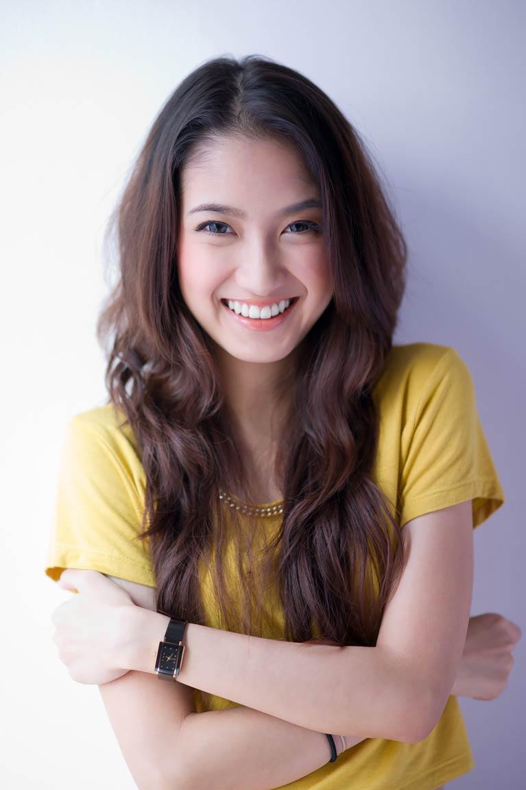 woman in yellow shirt smiling