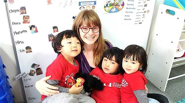 English Kindergarten teacher with kids