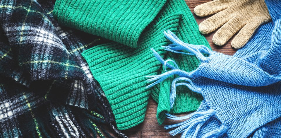 Scarves in blue and green, emerald green and pale blue, and a cream glove