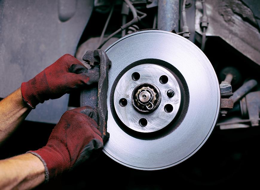 Mechanic changing brake pads