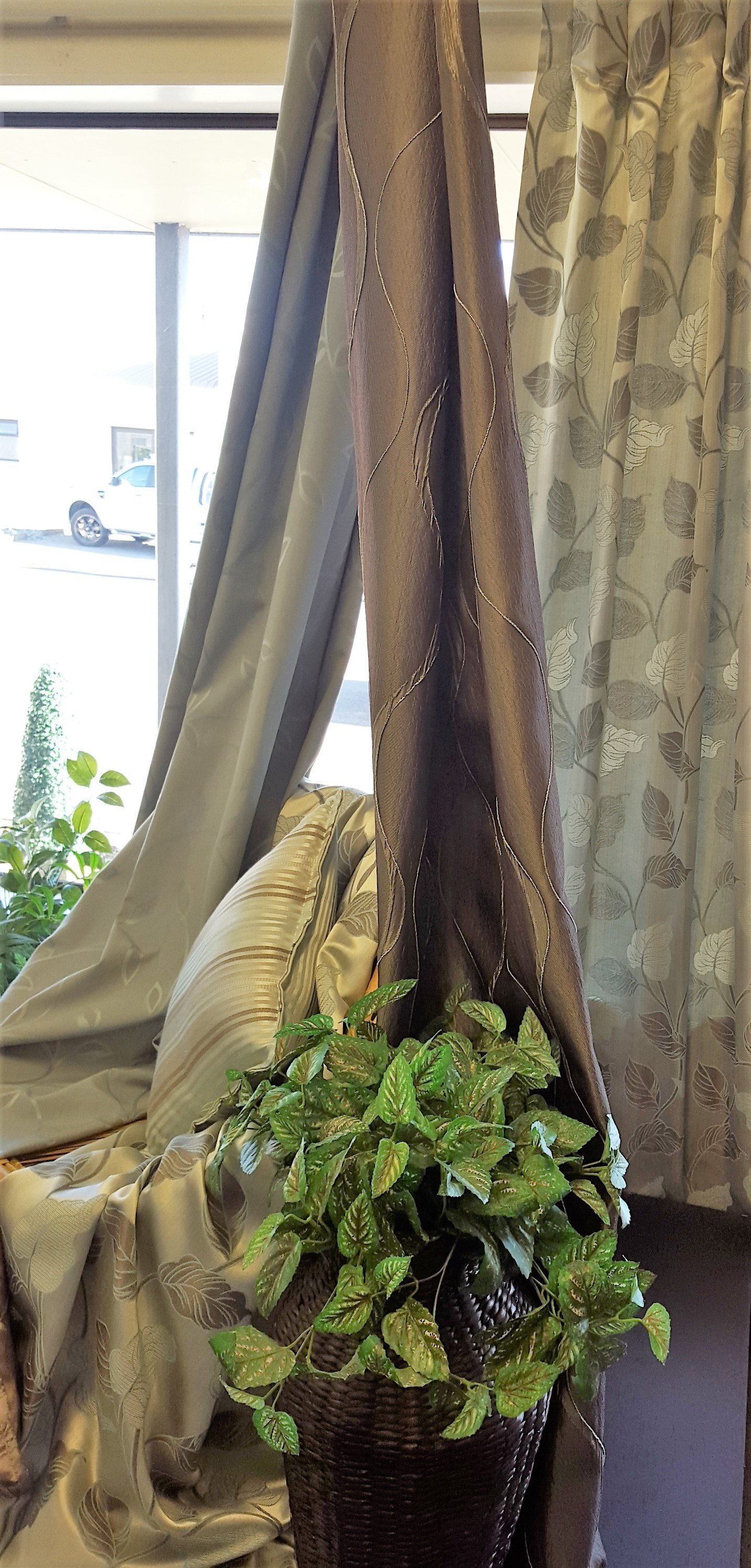 View of fine quality curtains with matching cushion covers