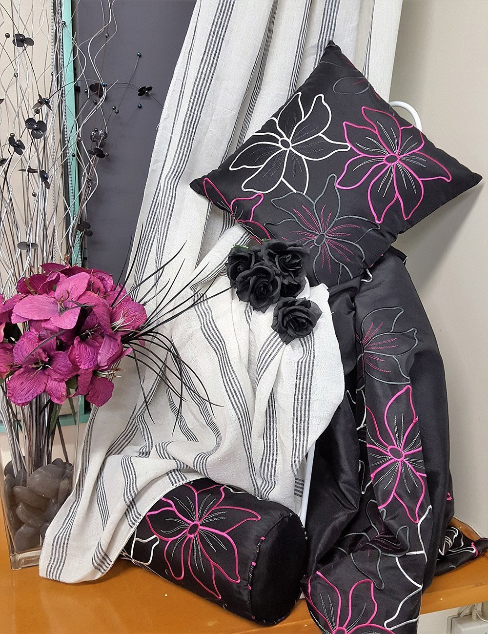 View of quality cushion cover and curtains