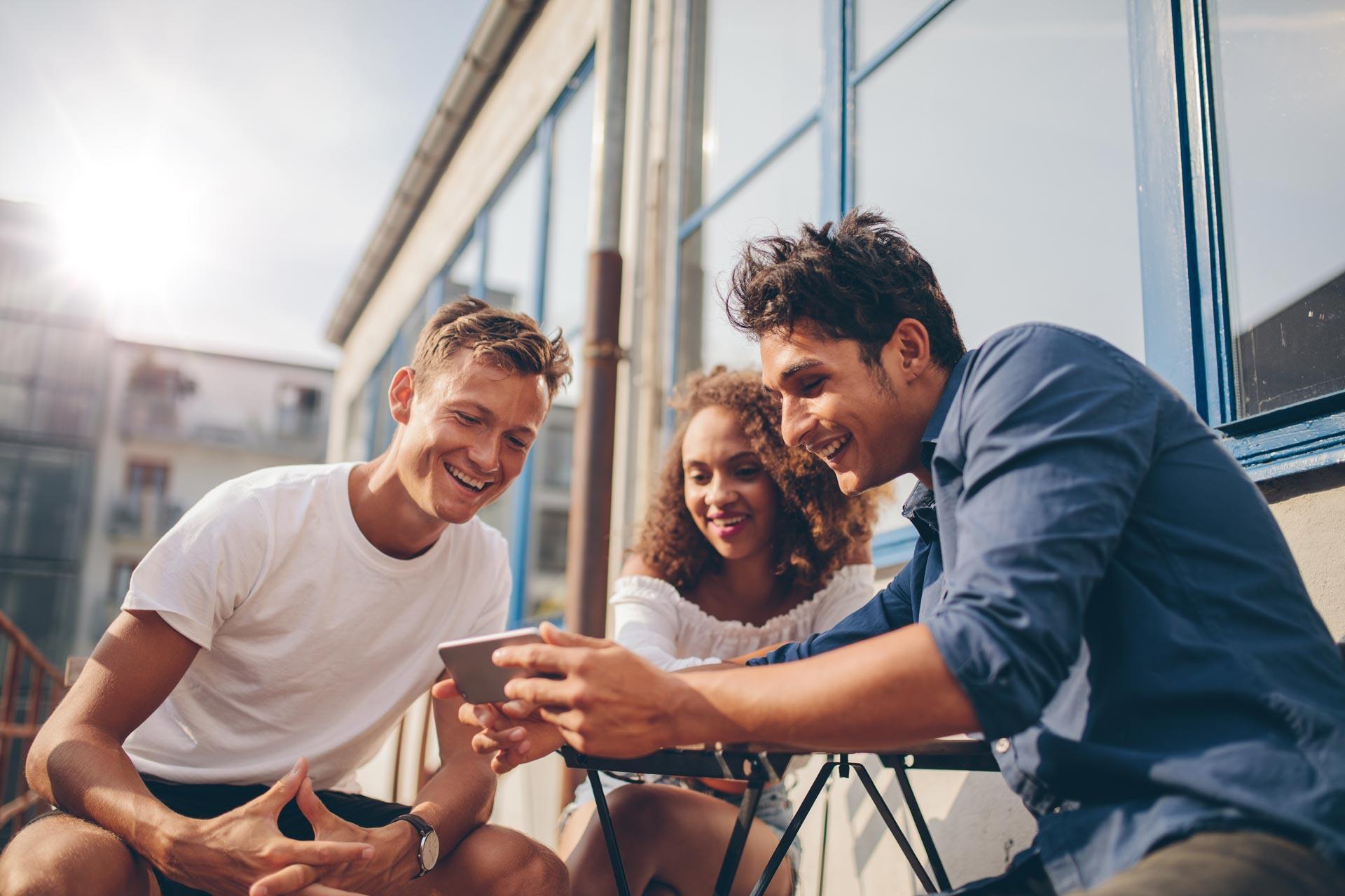 friends around a phone