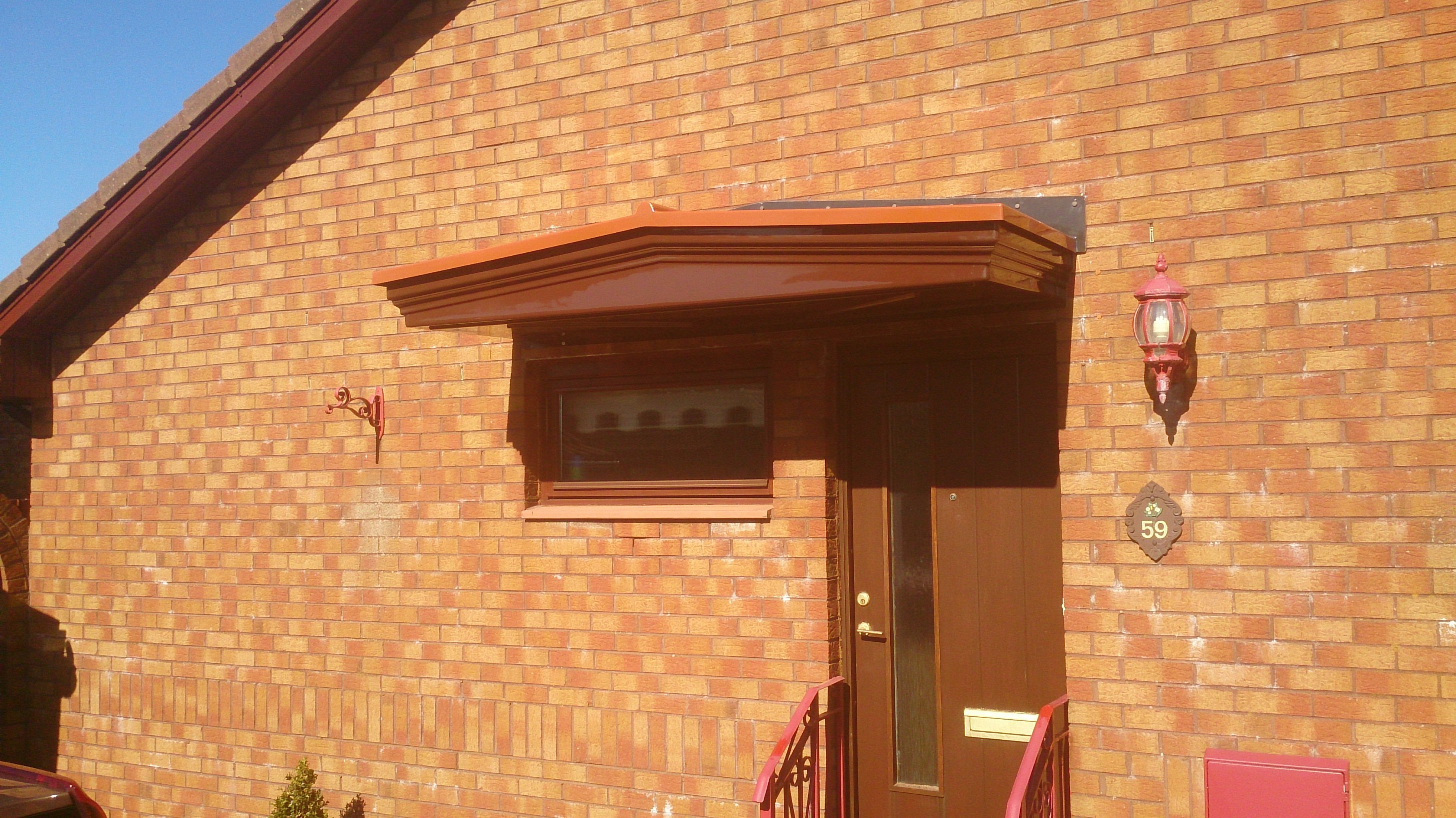Small door canopy