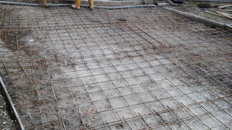 Posa di strato di cemento