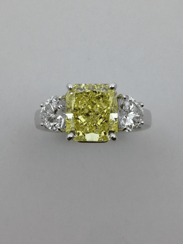 White gold ring with intensive yellow fancy diamond