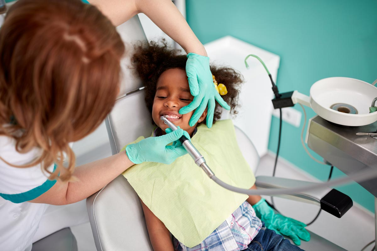 A child learns to brush her teeth from kids dentistry in Wheelers HIll