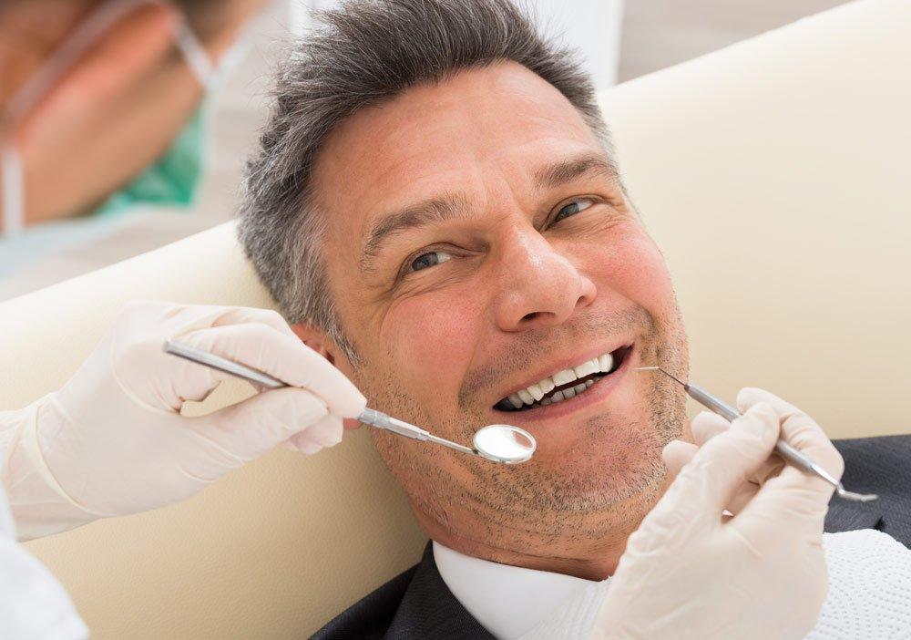 smiling male dental patient