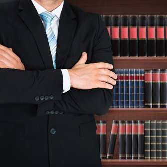 Social security attorney standing in front of law books in Cincinnati, OH