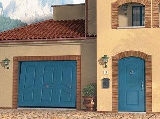 casa con portone e garage azzurro