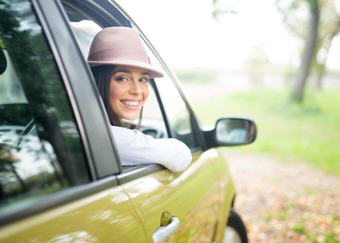 girl smiling in car